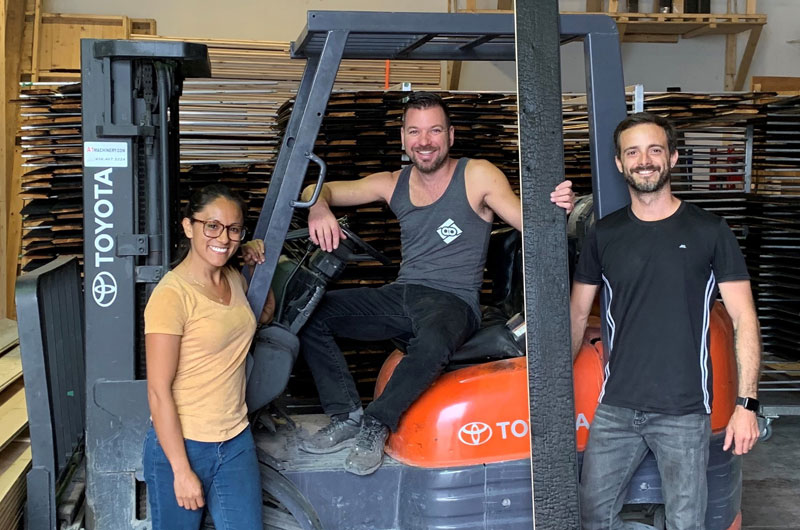 Daniel Bellerose, centre, seen here with some of his crew, founded Arbres et Bois specializing in Yakisugi burned wood.