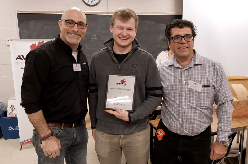 AWMAC Ontario's GIS Director Nick Anastas and AWMAC Ontario�s Education Director Onorio Centofanti present contest winner Caleb Perry with his award.